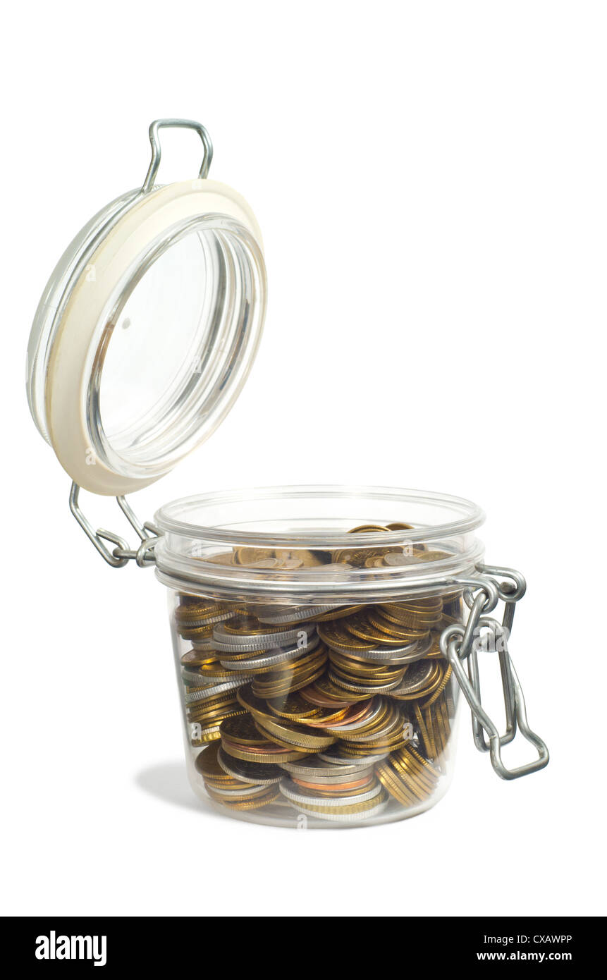 Coins in a jar isolated on white background - Stock Image