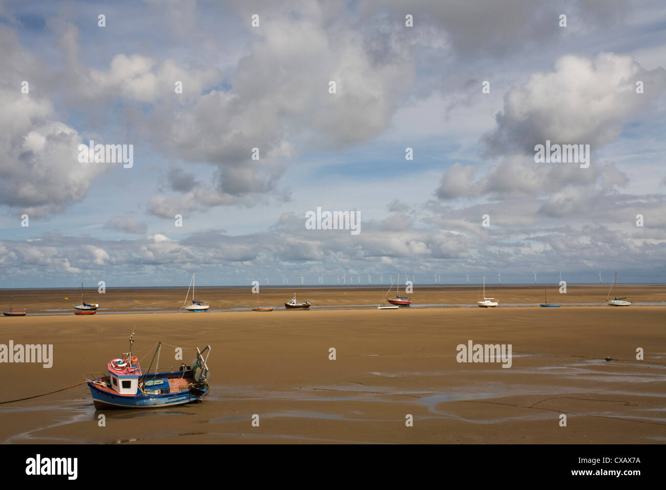 Boats on the beach near New Brighton, Wirral Peninsula, Merseyside, England, United Kingdom, Europe - Stock Image