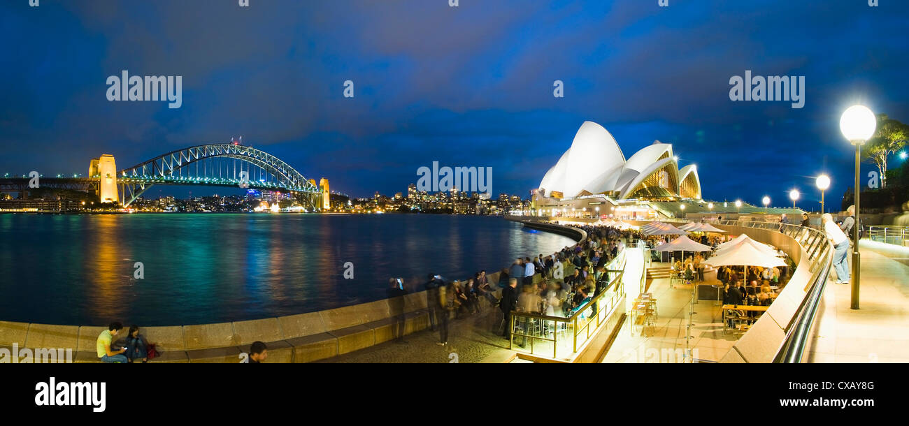 Sydney Opera House, Harbour Bridge, Opera Bar and Sydney Harbour at night, Sydney, New South Wales, Australia - Stock Image