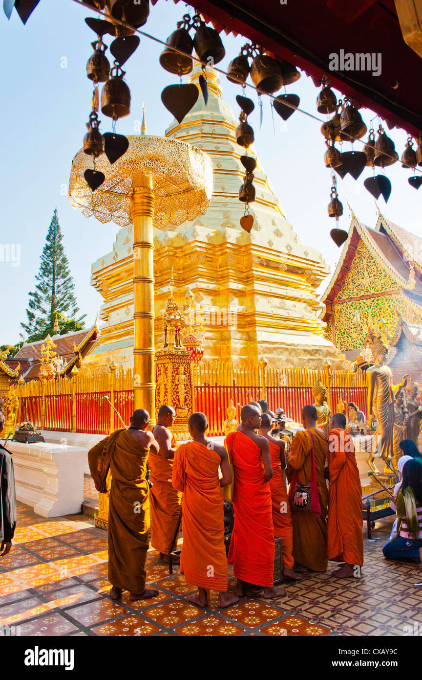 Group of Buddhist monks praying at Wat Doi Suthep Temple, Chiang Mai, Thailand, Southeast Asia, Asia - Stock Image