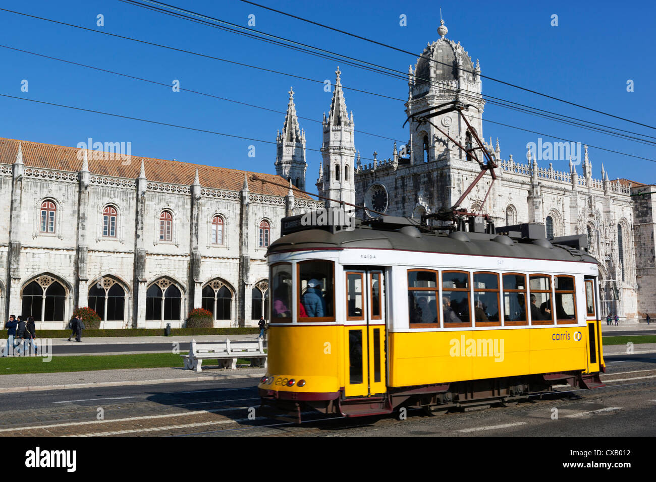 Mosteiro dos Jeronimos, UNESCO World Heritage Site, and tram (electricos), Belem, Lisbon, Portugal, Europe - Stock Image