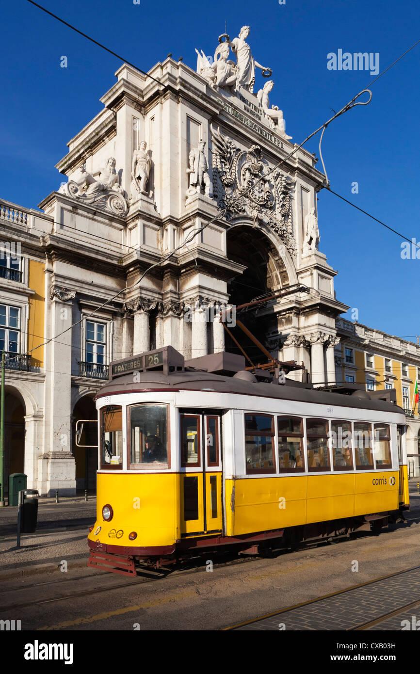 Tram (electricos) below the Arco da Rua Augusta in Praca do Comercio, Baixa, Lisbon, Portugal, Europe - Stock Image