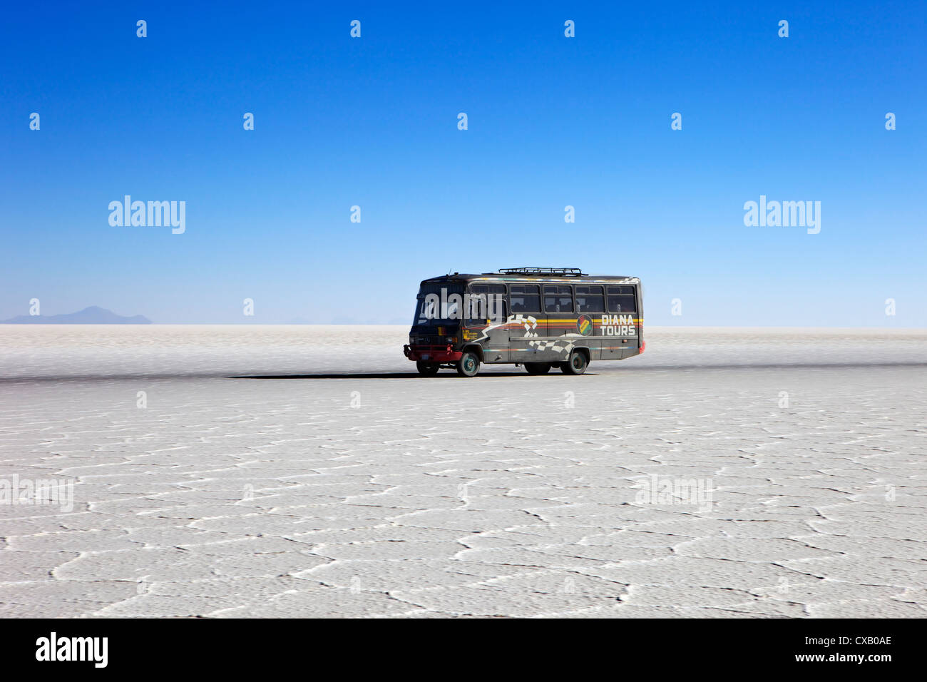 Bus on Salar de Uyuni, the largest salt flat in the world, South West Bolivia, South America - Stock Image