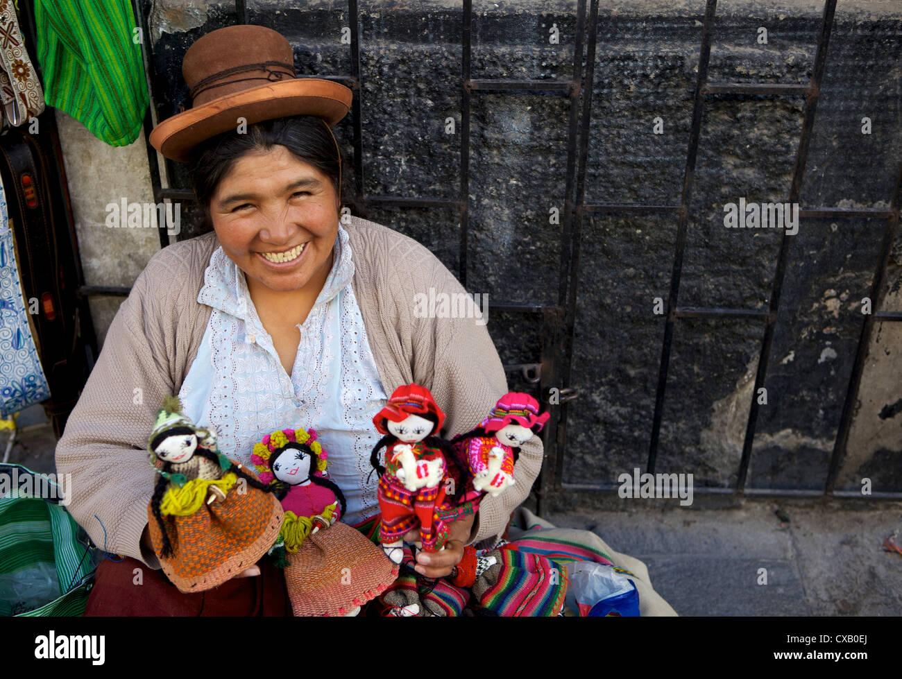 Indigenous lady selling dolls, Arequipa, Peru, South America - Stock Image