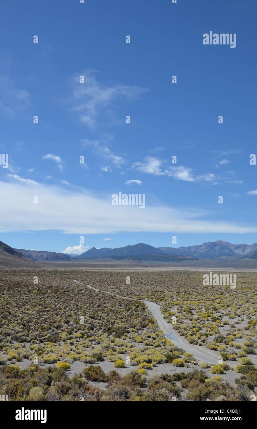Dusty desert road, Mono Country, California - Stock Image