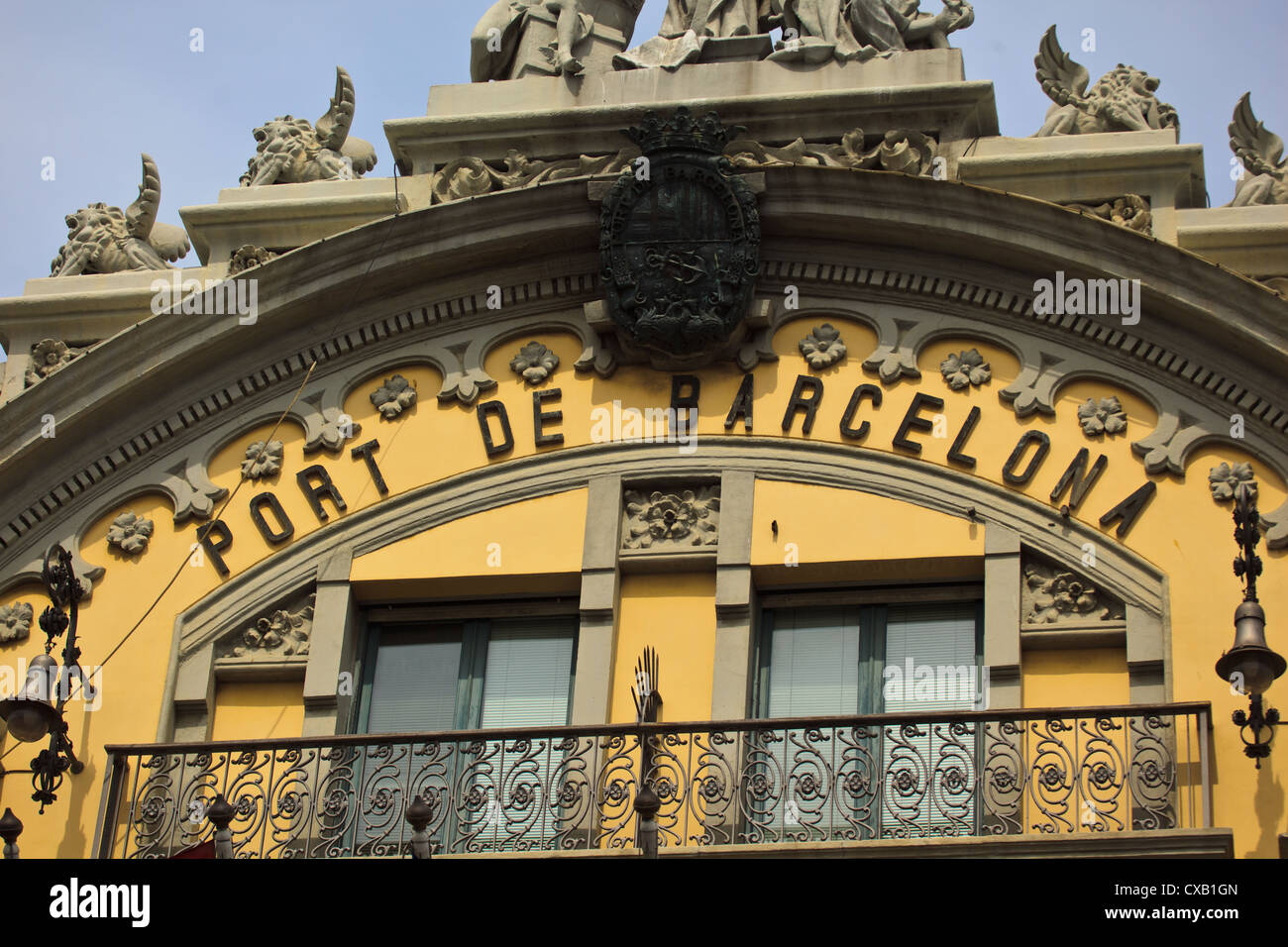 Port of Barcelona sign above balcony with decorative iron railing on old Port Authority building - Stock Image