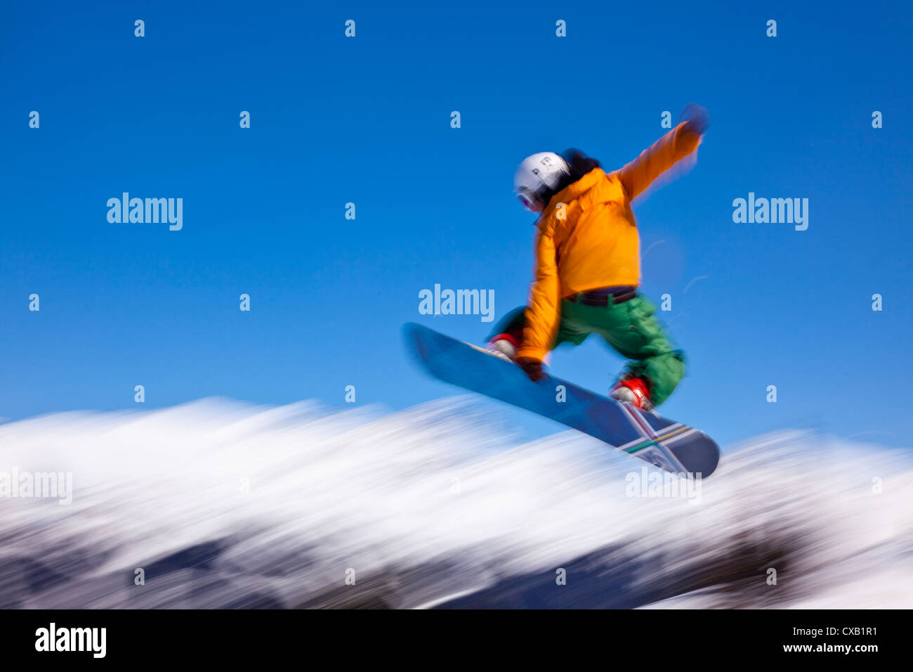Snowboarder flying off a ramp, Whistler Mountain, Whistler Blackcomb Ski Resort, Whistler, British Columbia, Canada Stock Photo