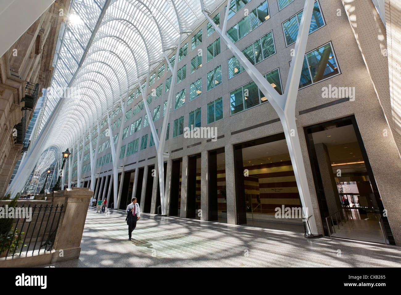 Businessman walking through the galleria atrium, Brookfield Place, previously known as BCE Place, Toronto, Ontario, - Stock Image