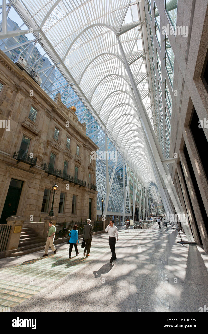 Pedestrians walking through the galleria atrium, Brookfield Place, previously known as BCE Place, Toronto, Ontario, - Stock Image