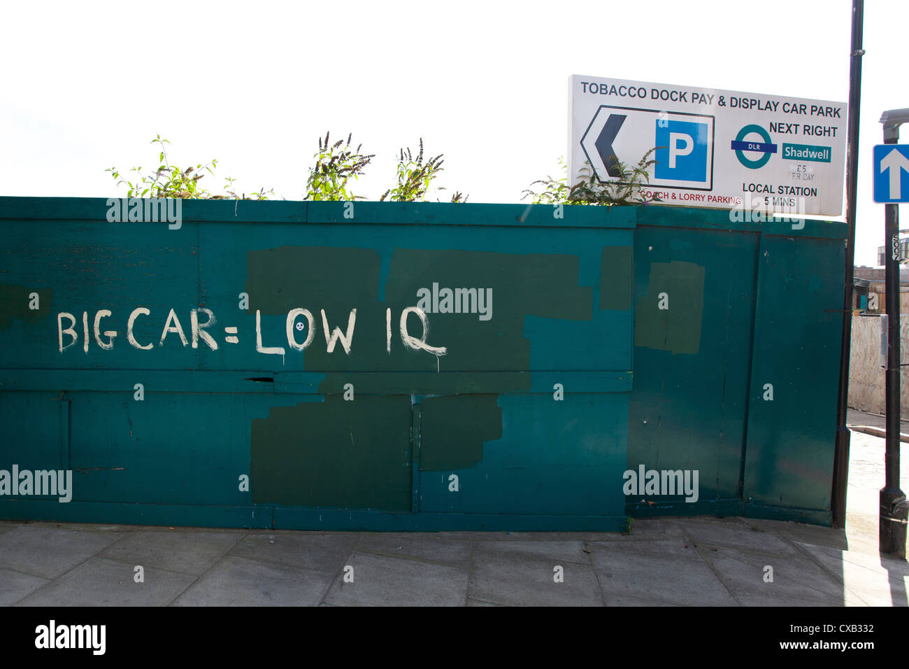 BIG CAR = LOW IQ painted on wooden boards, The Highway, Wapping, London, England, UK. - Stock Image