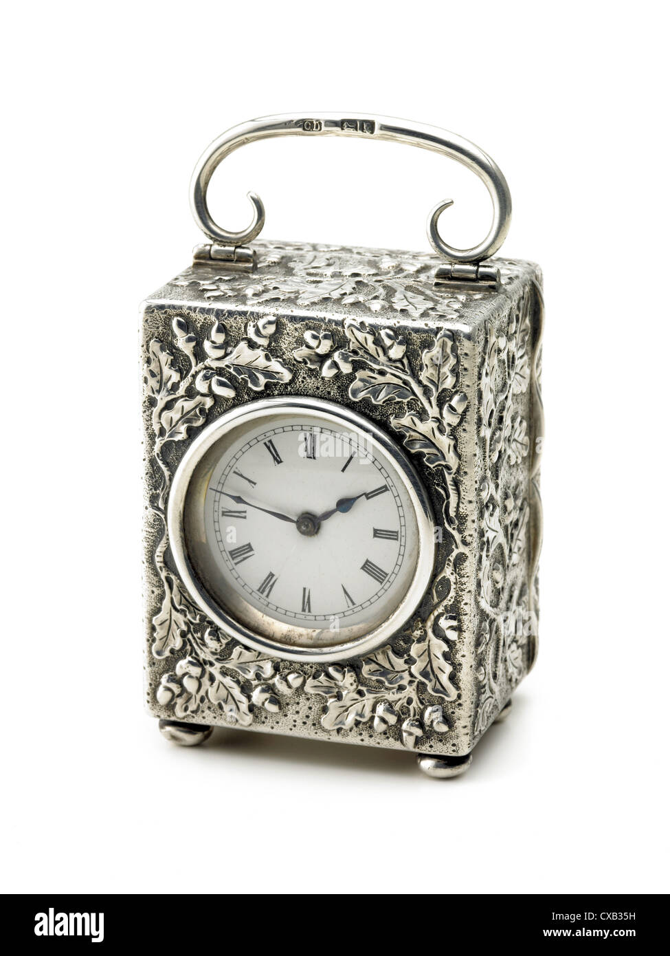 miniature, silver cased carriage clock - Stock Image