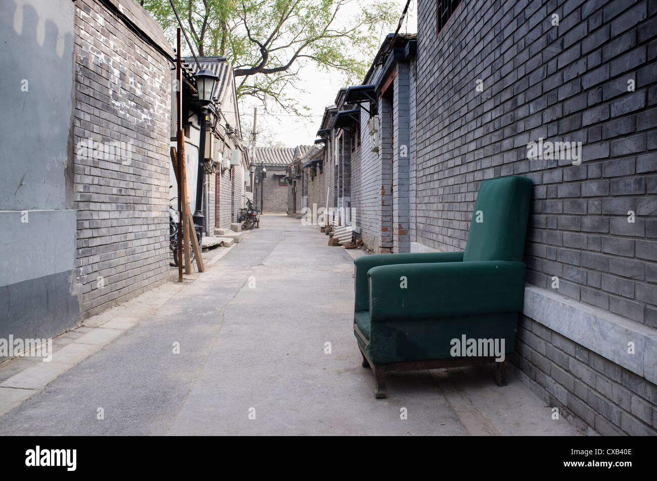 Green chair in empty hutong or lane in Beijing china - Stock Image