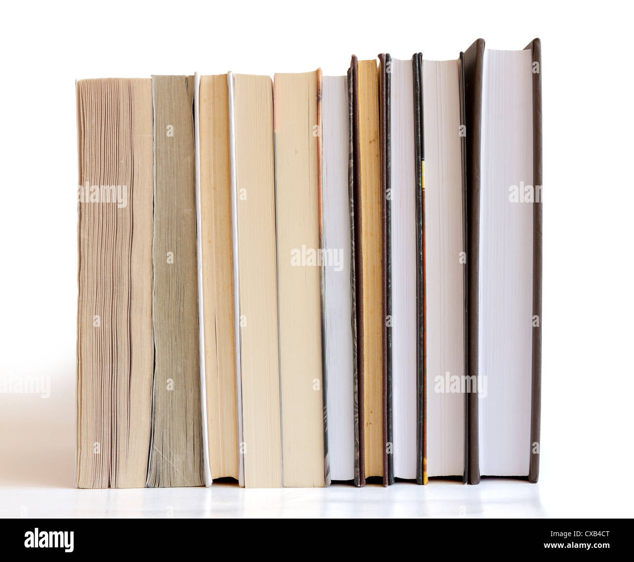 Books in a row isolated on white background - Stock Image