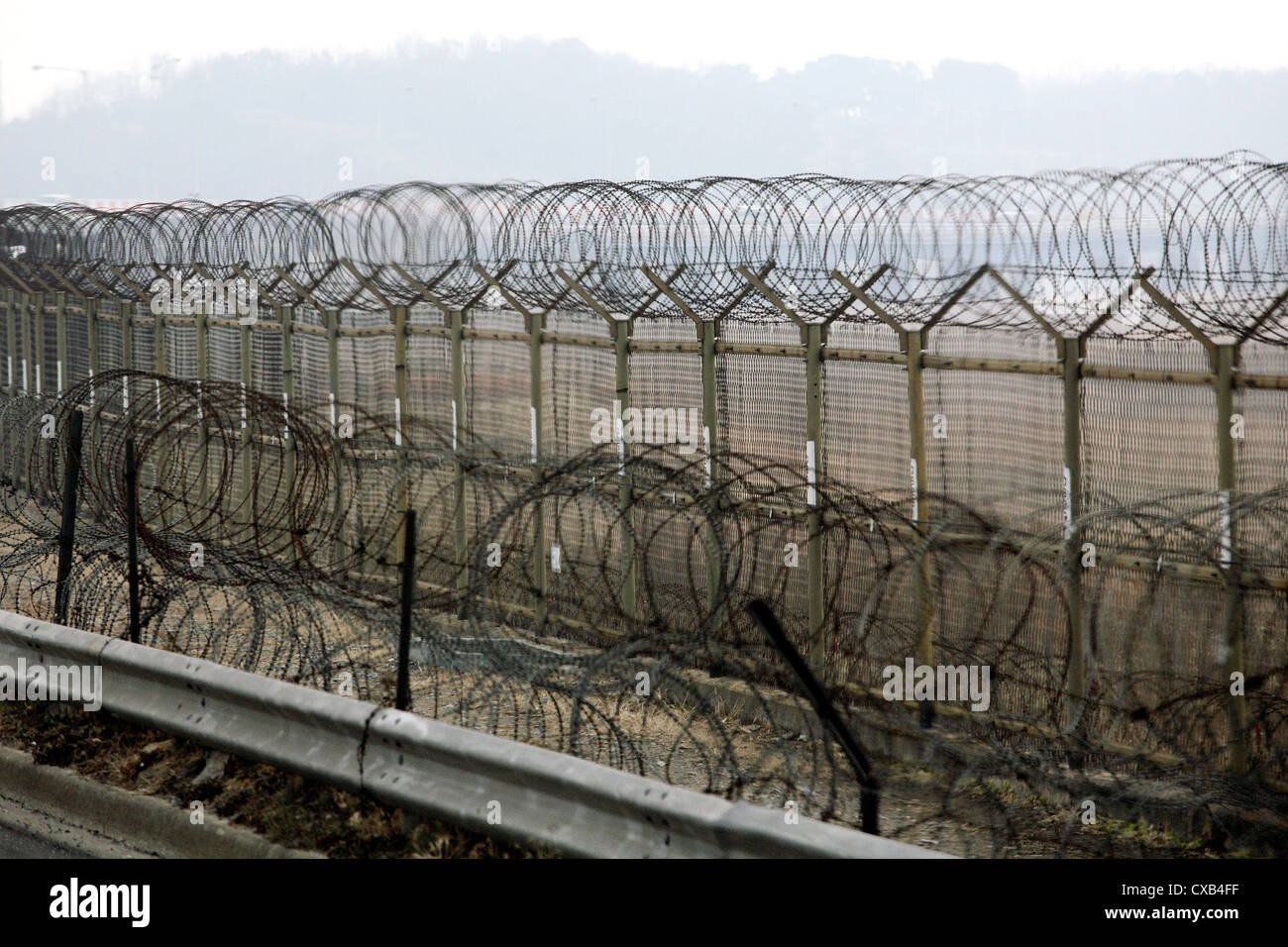 Odusan, secured with barbed wire border installations on North Korea - Stock Image