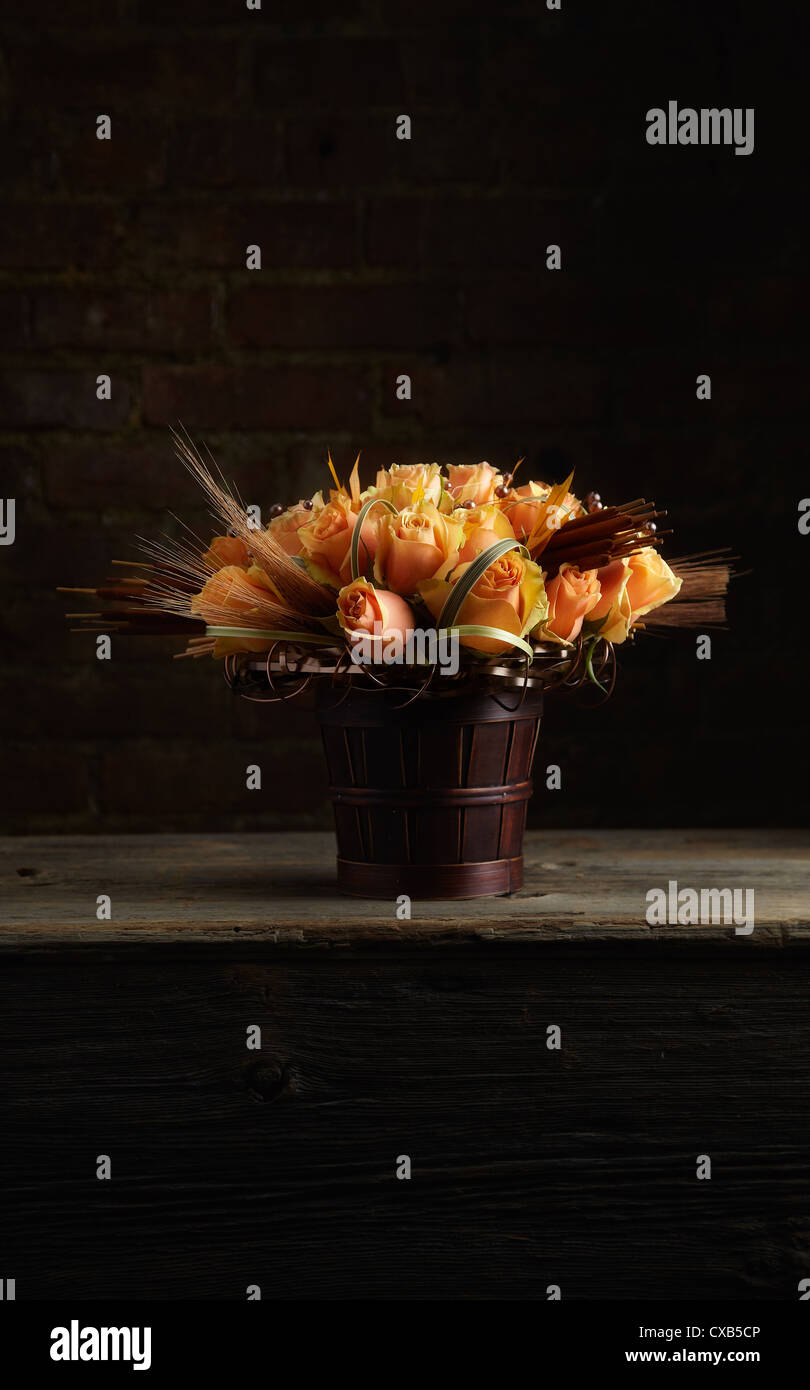 Peach Rose Fall Flower Arrangement - Stock Image