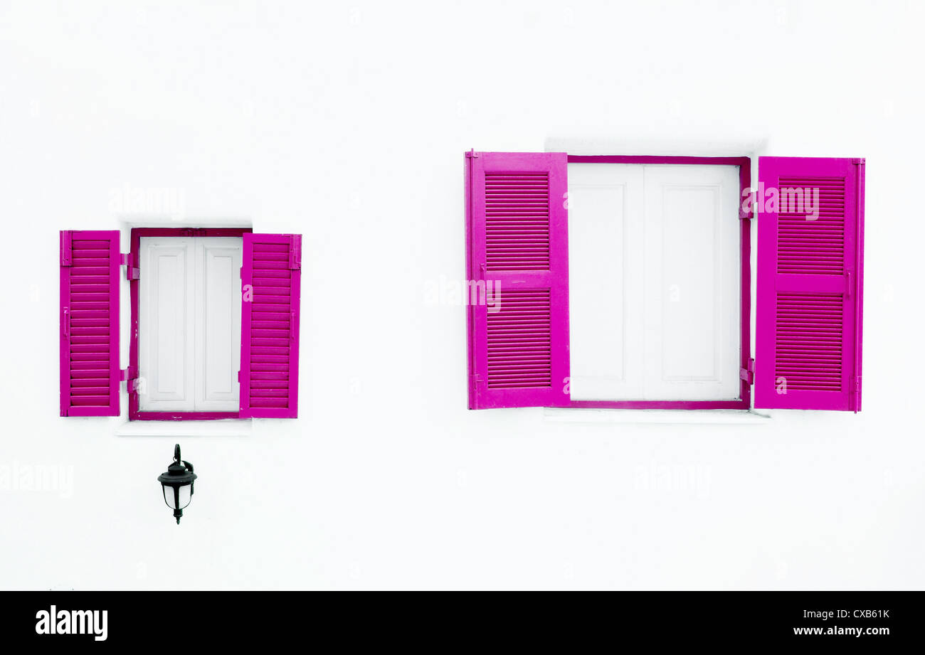 pink Greek Style windows and lamp on white wall Stock Photo