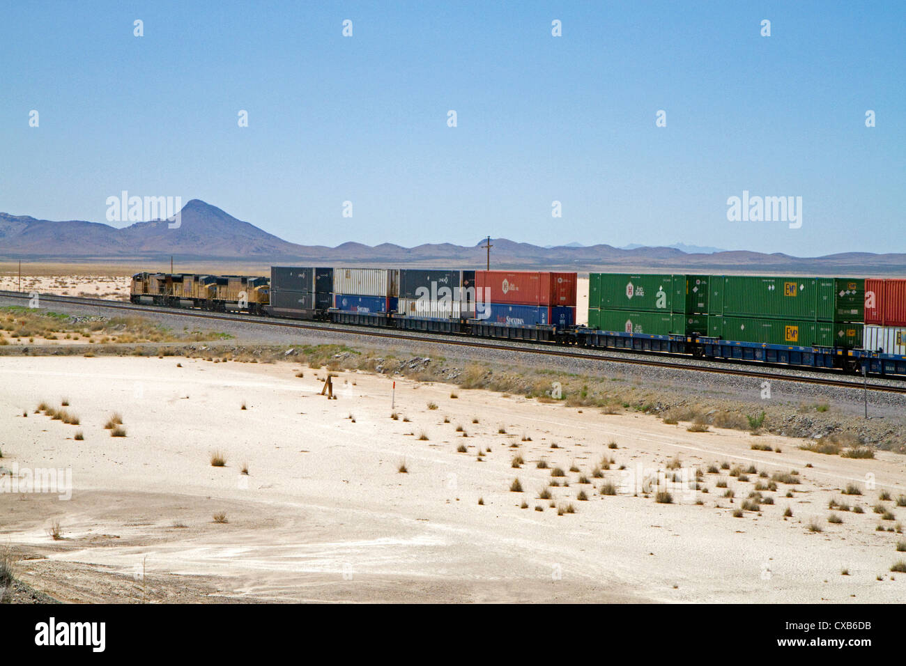 Union Pacific Railroad locomotive traveling along Interstate 10 through southwest New Mexico, USA. - Stock Image