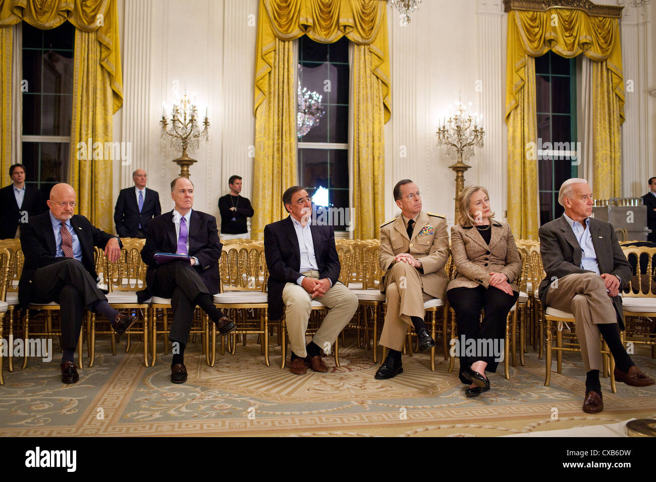 Senior administration officials listen as President Barack Obama delivers a statement May 1, 2011 in the East Room - Stock Image