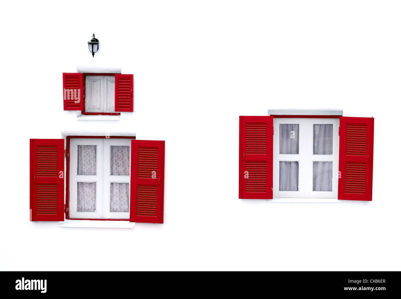 red Greek Style windows and lamp on white wall Stock Photo