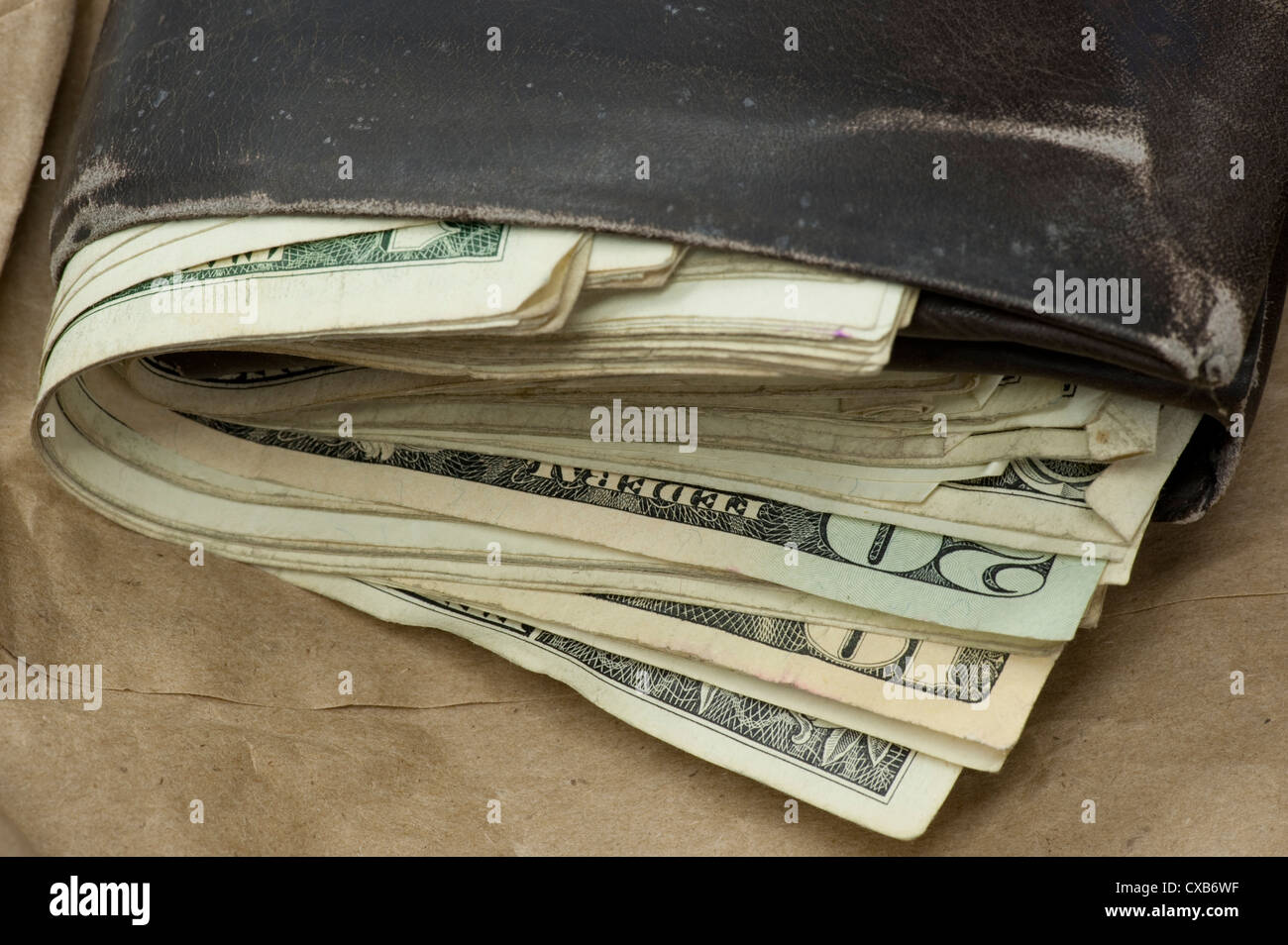 closeup of well worn wallet with large number of bills US - Stock Image