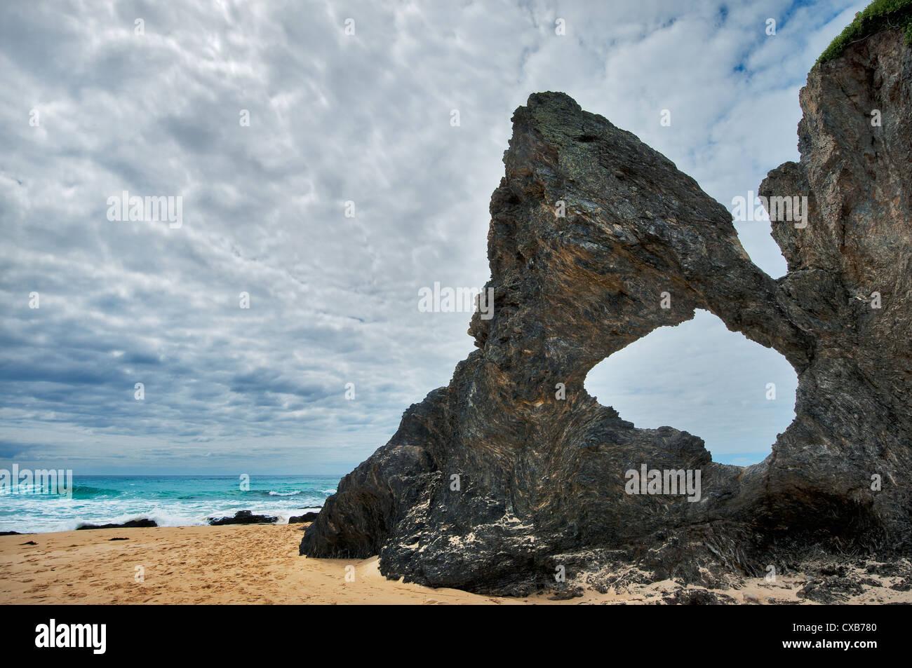 Famous Australia Rock at the beach of Narooma. Stock Photo