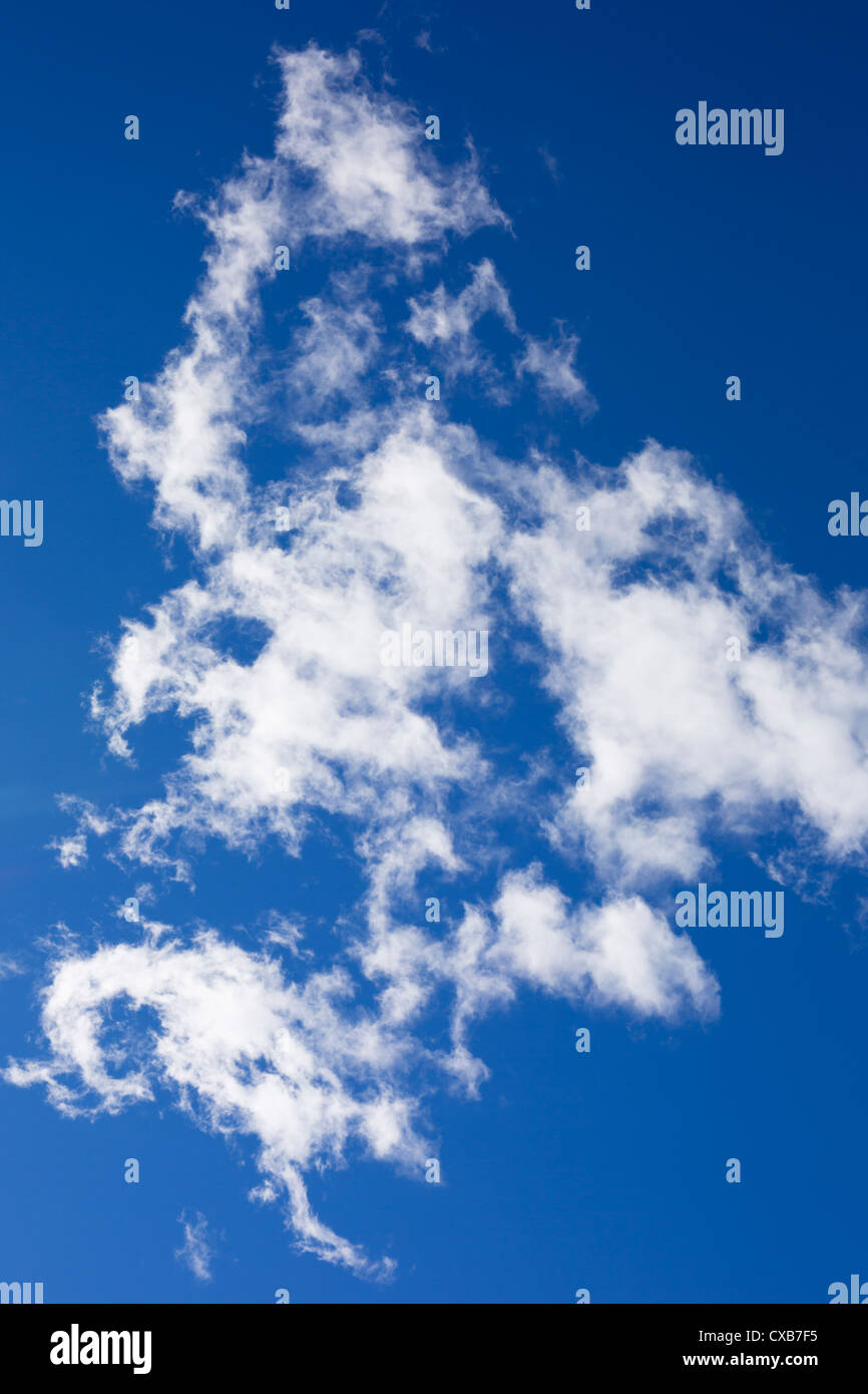 White wispy clouds in a blue sky. - Stock Image