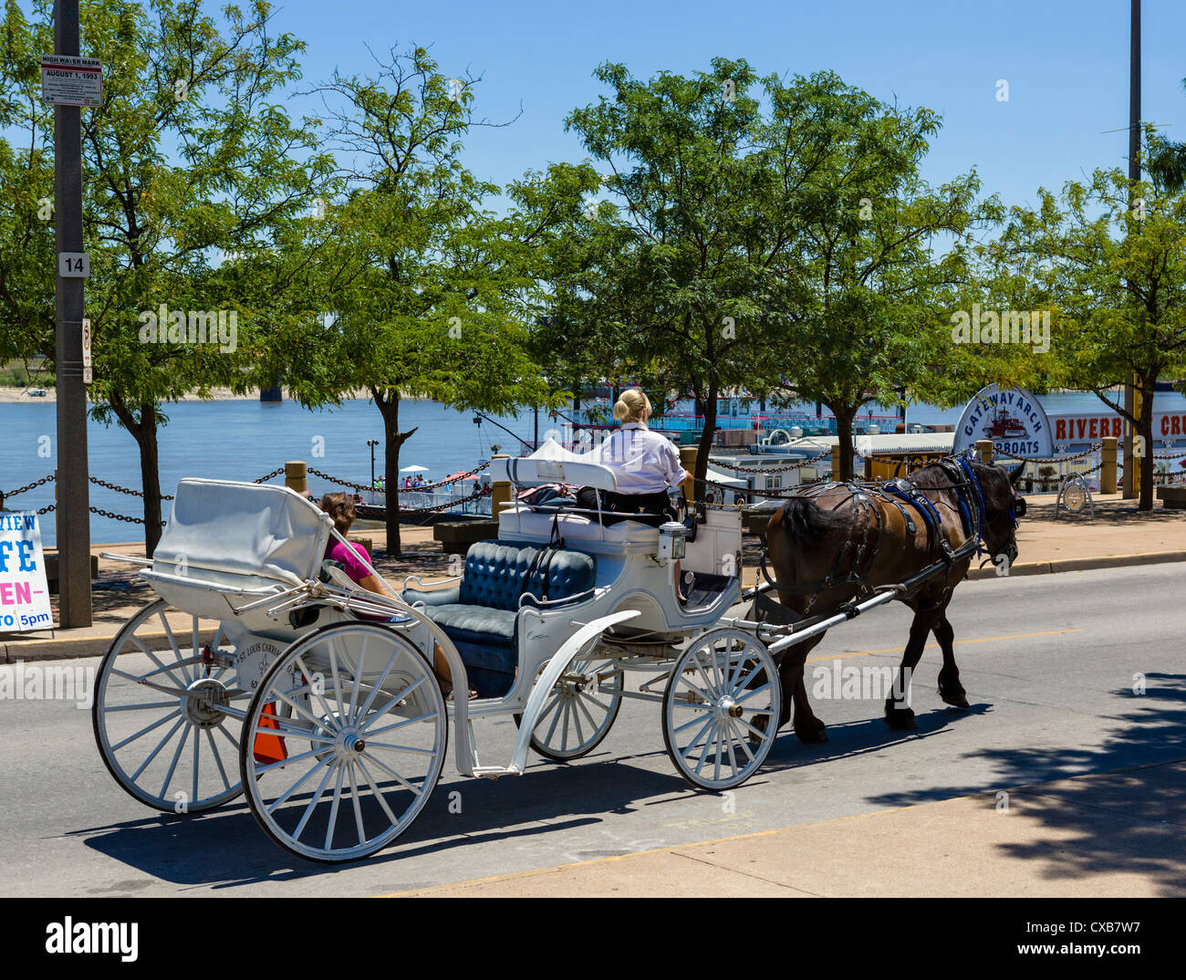 Horsedrawn carriage right along the Mississippi riverfront, Jefferson National Expansion Memorial, St Louis, Missouri, - Stock Image