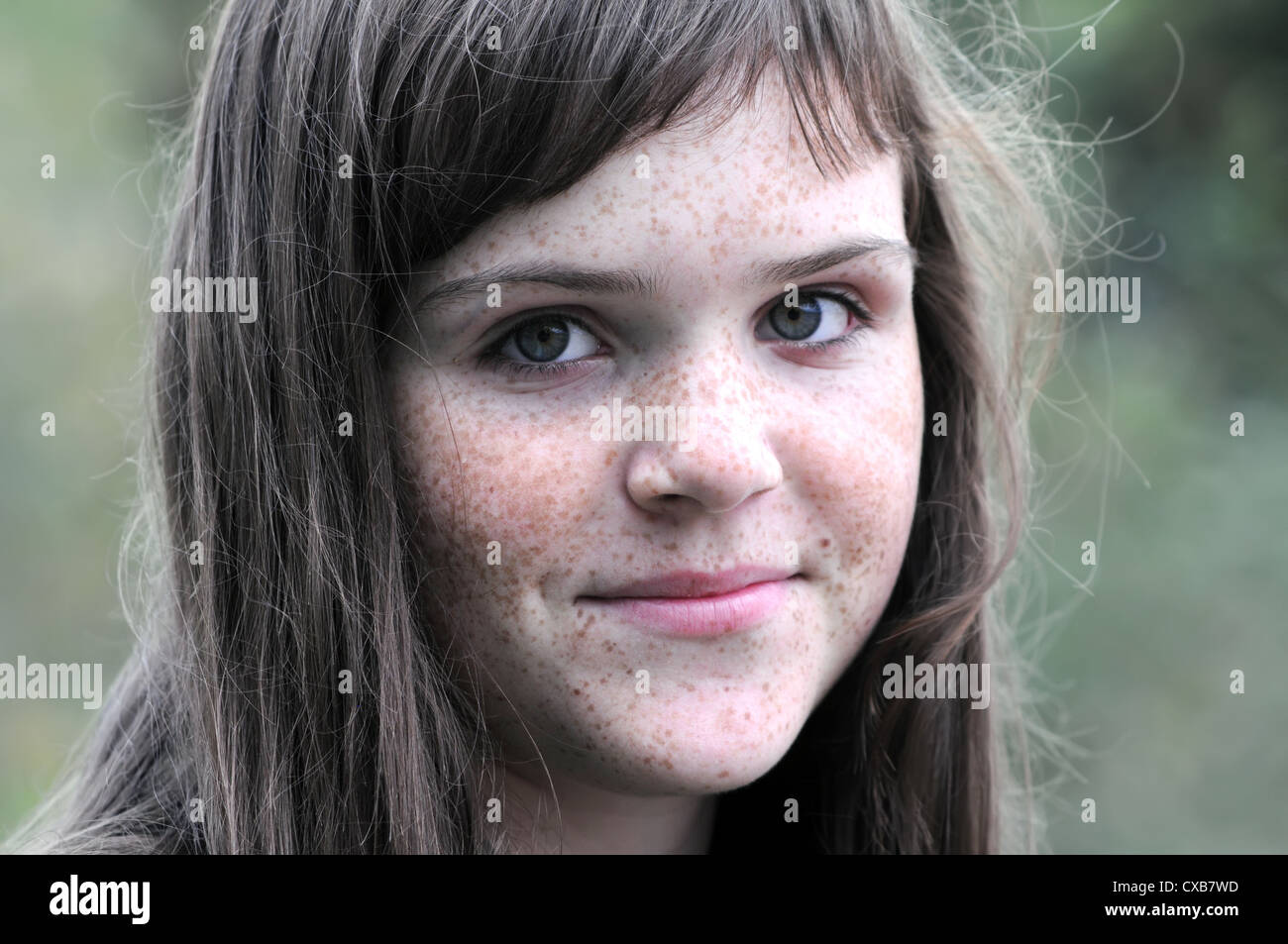 outdoors portrait of freckled teenage girl - Stock Image