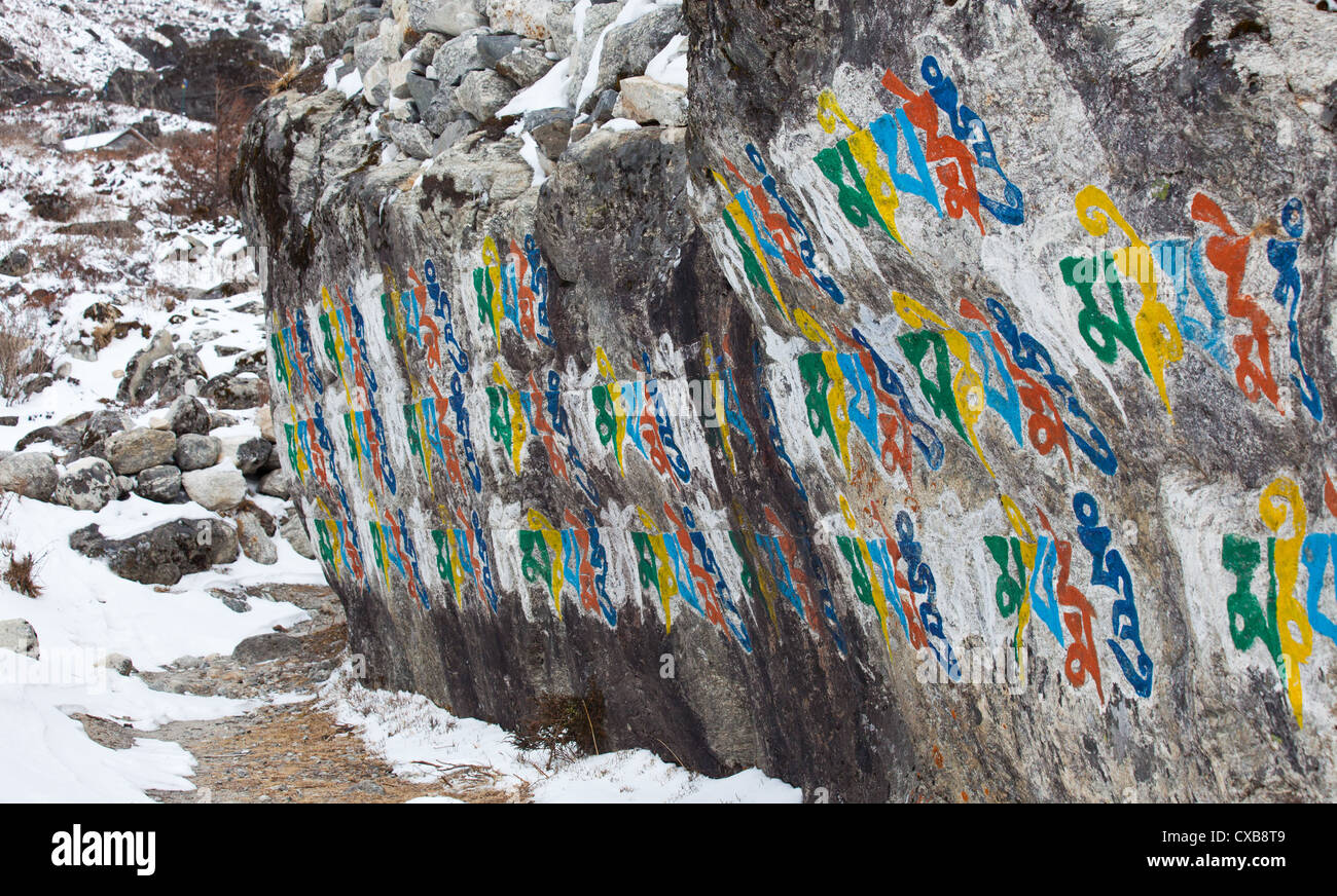 Stone wall with a buddhist mantra writen in nepali script langtang stone wall with a buddhist mantra writen in nepali script langtang valley nepal altavistaventures Image collections