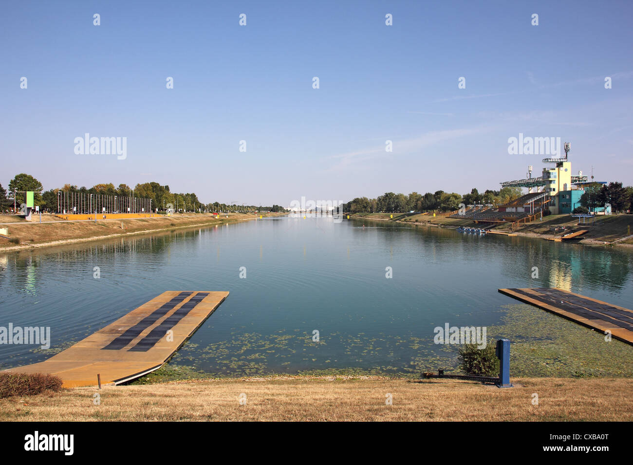 Rowing track with eight lanes for racing boats and bleachers for spectators - Stock Image