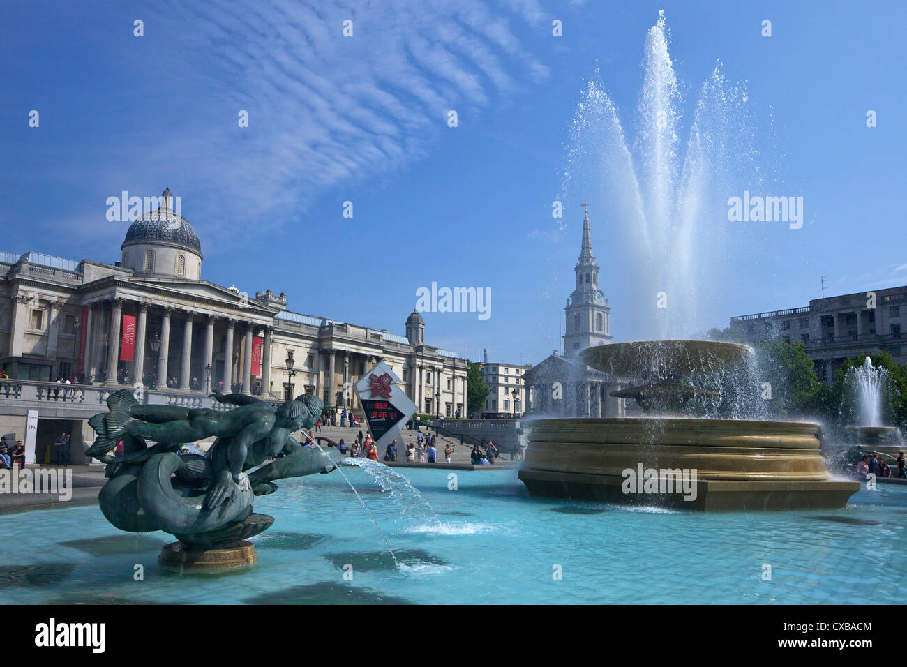 Tritons and dolphin fountain with the Olympic digital countdown clock and the National Gallery, Trafalgar Square, Stock Photo