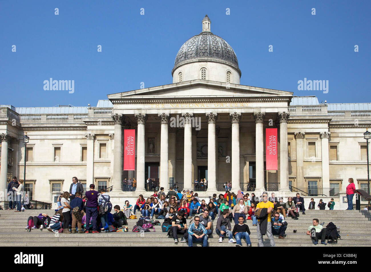 Visitors and tourists outside the National Gallery, Trafalgar Square, London, England, United Kingdom, Europe Stock Photo