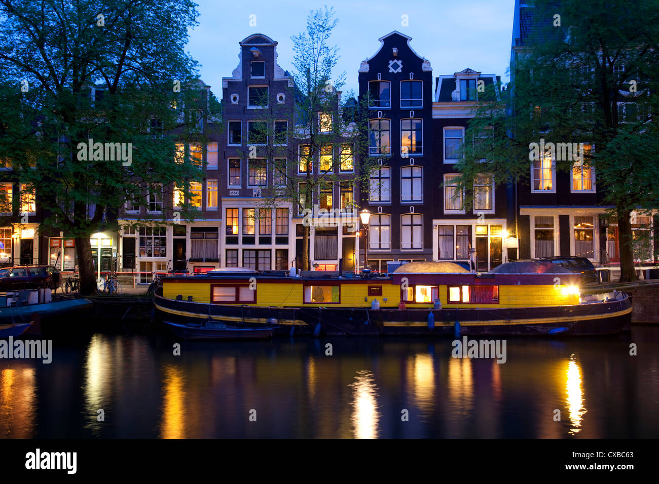 Canal boat and architecture, Amsterdam, Holland, Europe - Stock Image