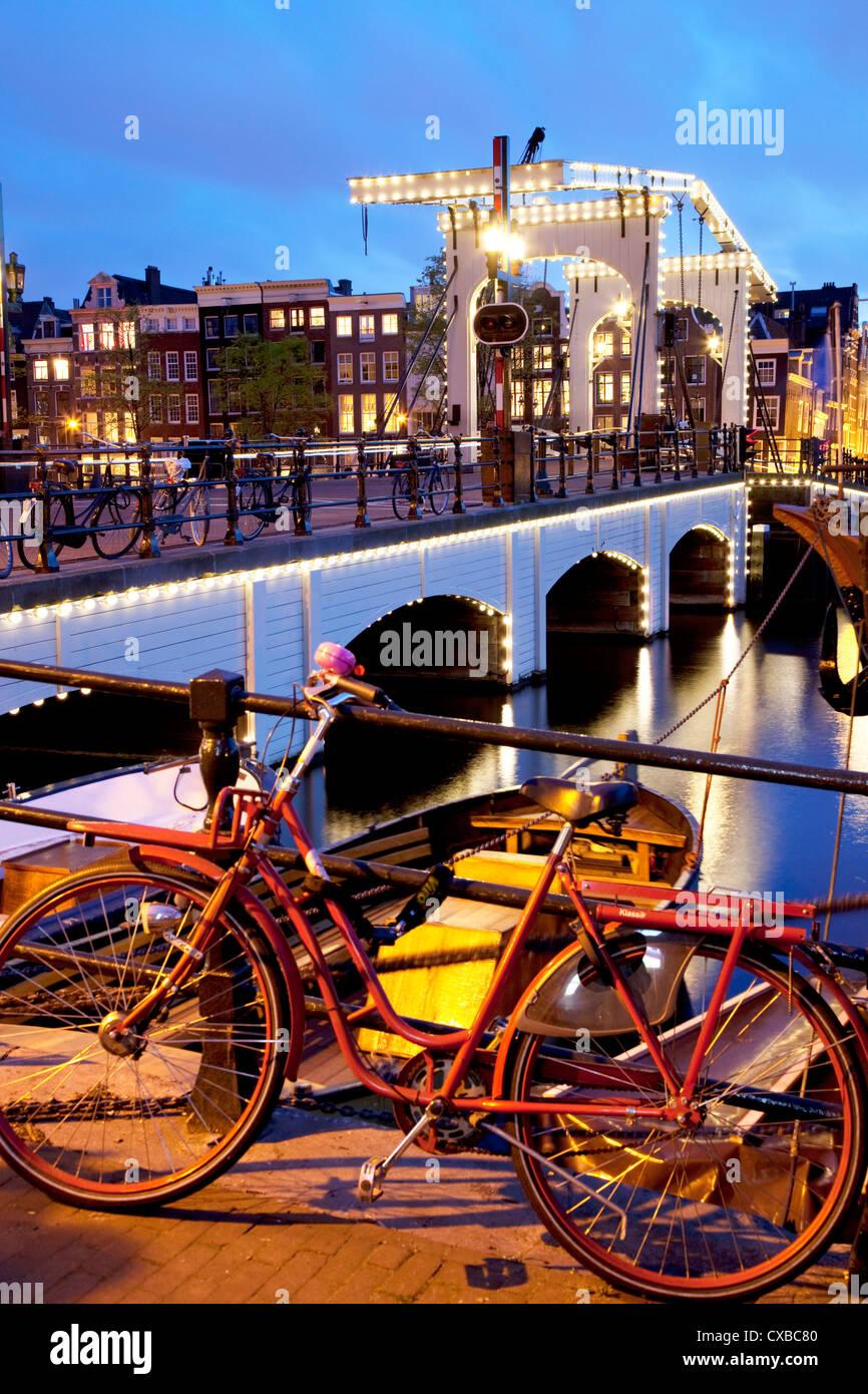 Magere Brug (Skinny Bridge) at dusk, Amsterdam, Holland, Europe - Stock Image