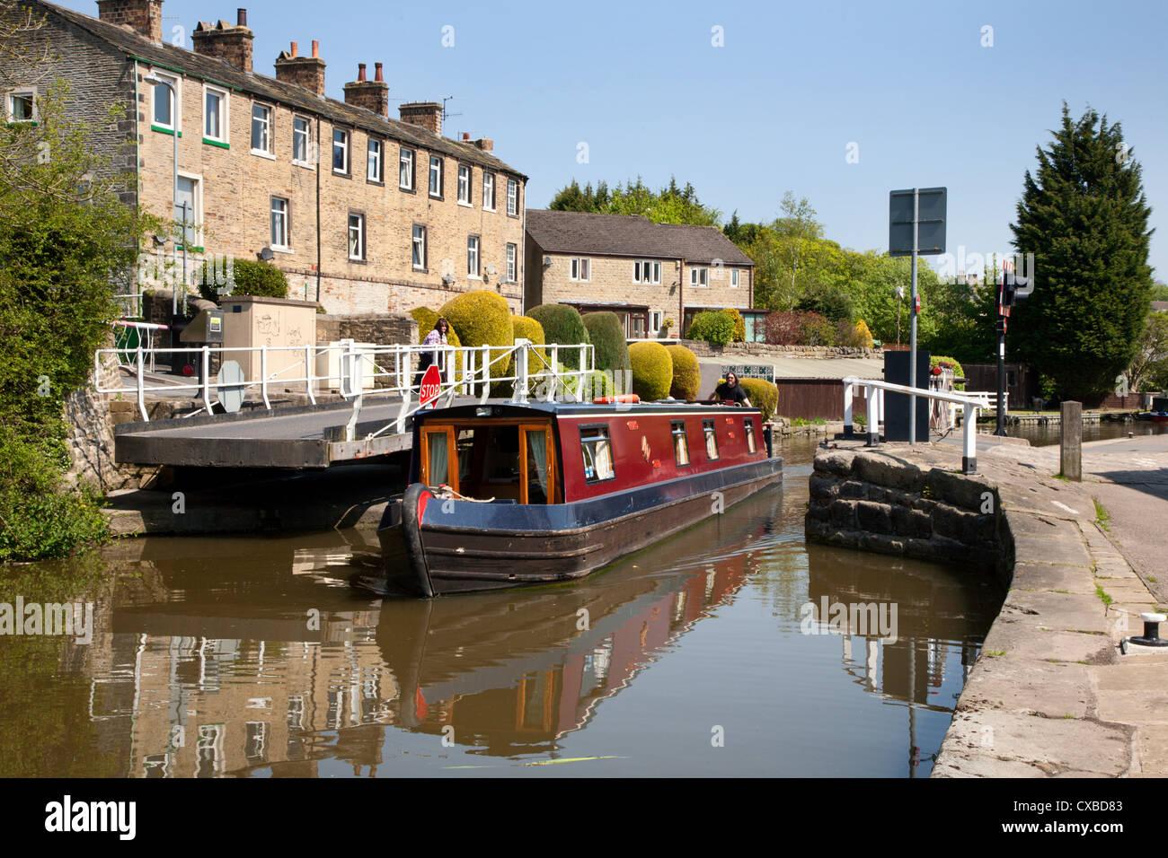 Narrowboat passing a Swing Bridge at Skipton, North Yorkshire, Yorkshire, England, United Kingdom, Europe - Stock Image
