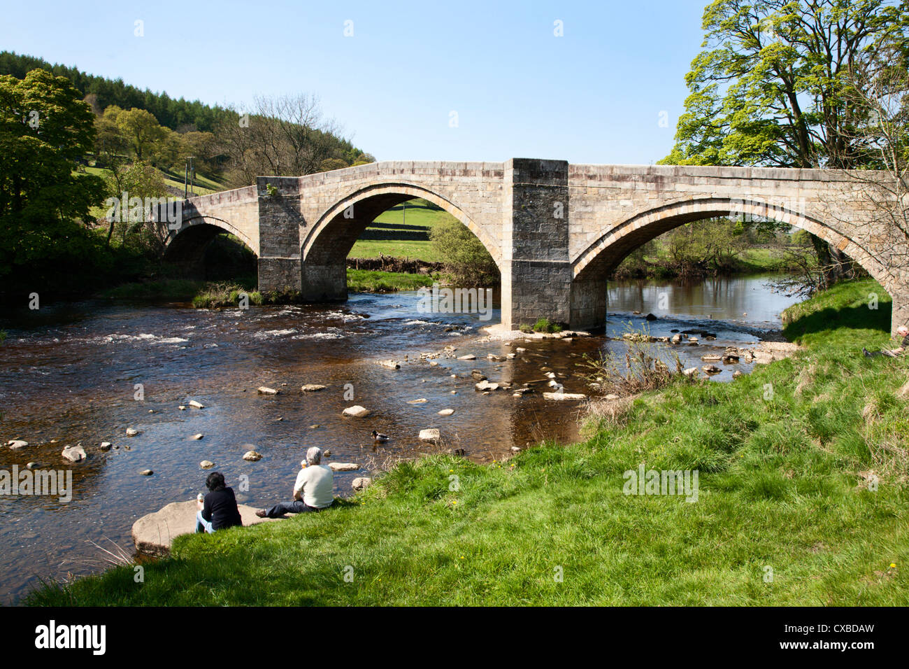 People eating ice cream at Barden Bridge over the River Wharfe, Wharfedale, Yorkshire Dales, Yorkshire, England, - Stock Image