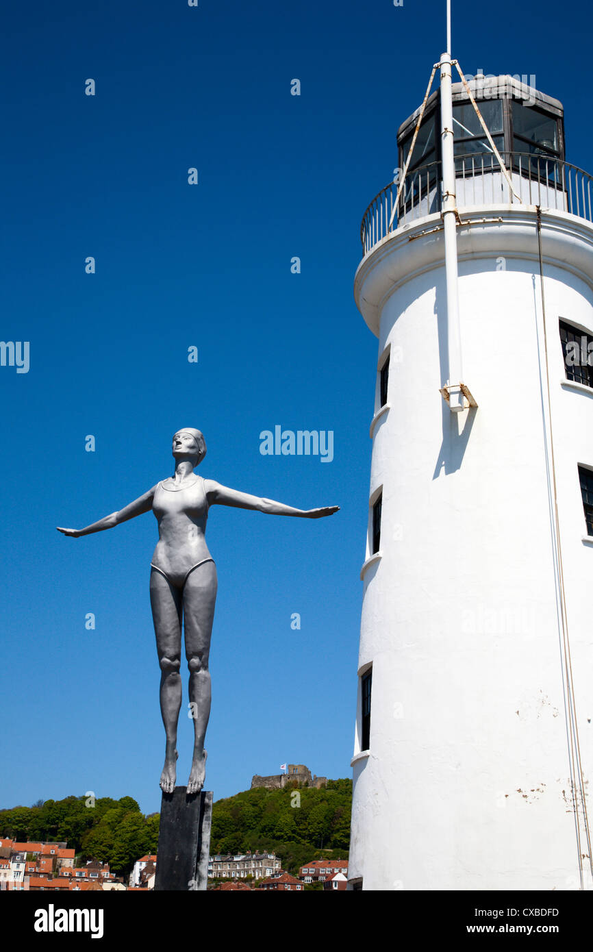 The Diving Belle Sculpture and Lighthouse on Vincents Pier, Scarborough, North Yorkshire, Yorkshire, England, United - Stock Image