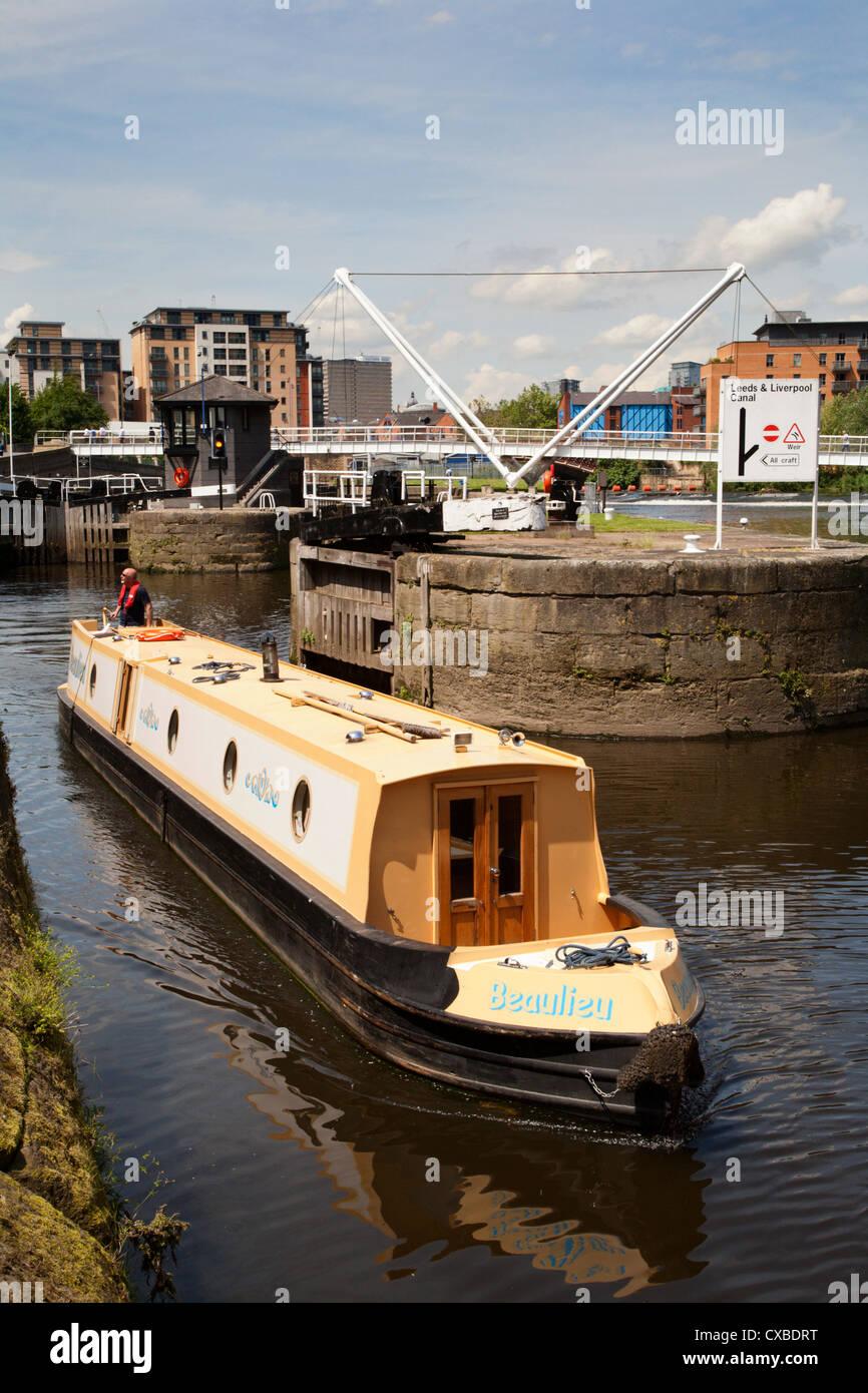 Narrowboat navigating Leeds Lock No 1 Aire and Calder Navigation, Leeds, West Yorkshire, Yorkshire, England, United - Stock Image