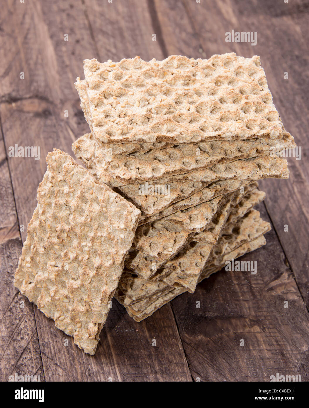 Stacked Crispbread on wooden background - Stock Image