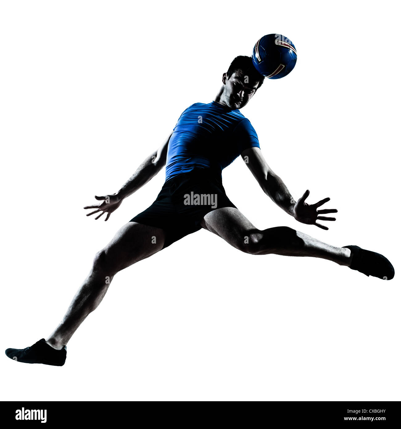 one caucasian man heading playing soccer football player silhouette  in studio isolated on white background - Stock Image