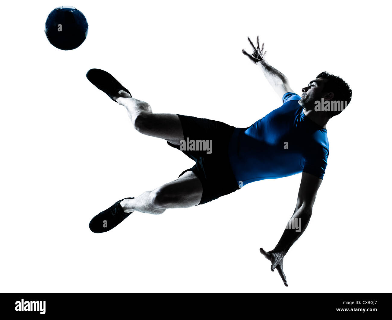 one caucasian man flying kicking playing soccer football player silhouette  in studio isolated on white background - Stock Image