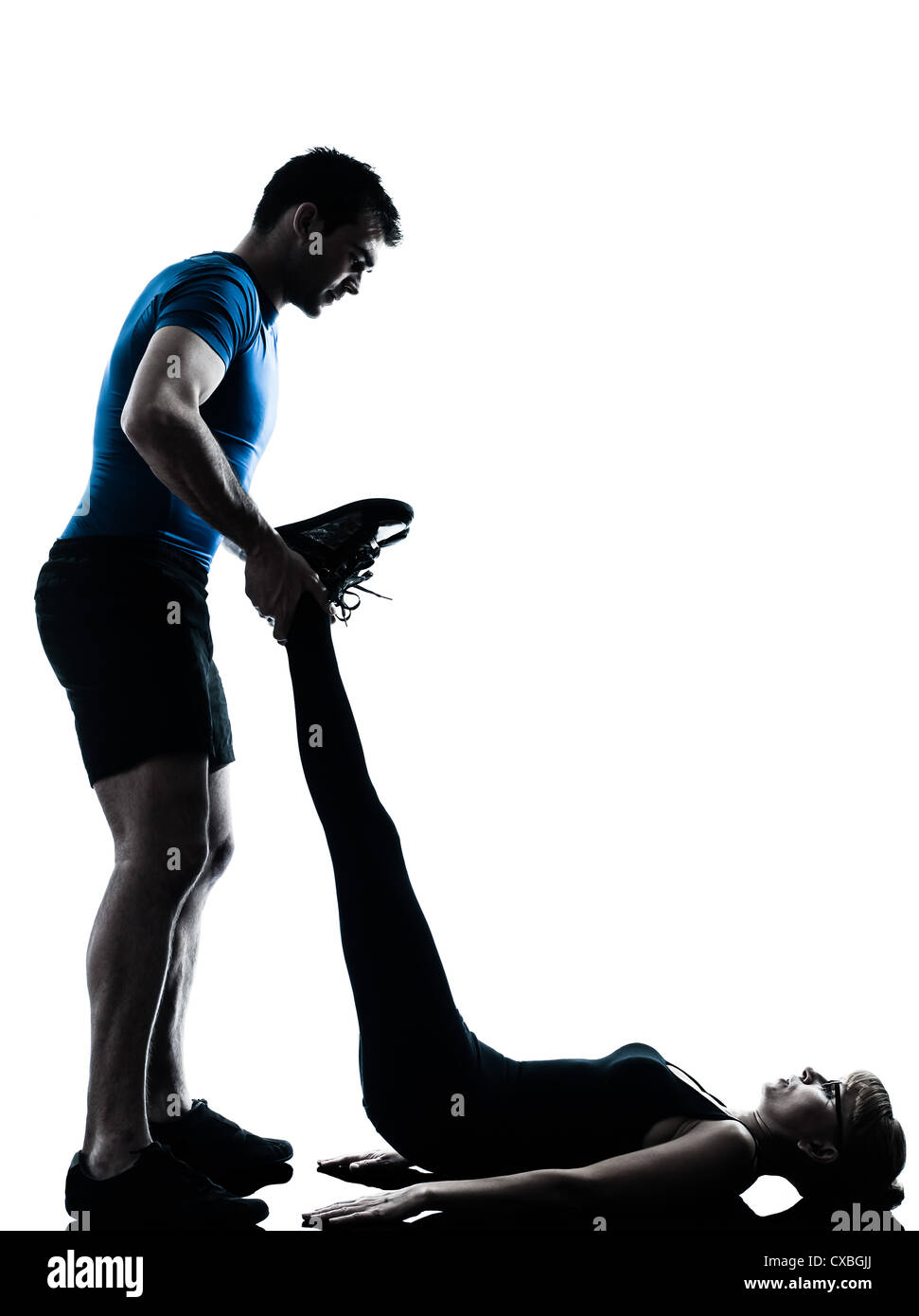 caucasian aerobics instructor  with mature woman exercising fitness workout in silhouette studio isolated on white Stock Photo