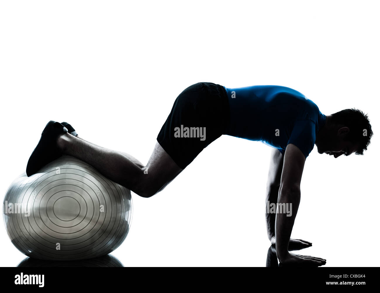 one caucasian man exercising workout fitness ball in silhouette studio  isolated on white background - Stock Image