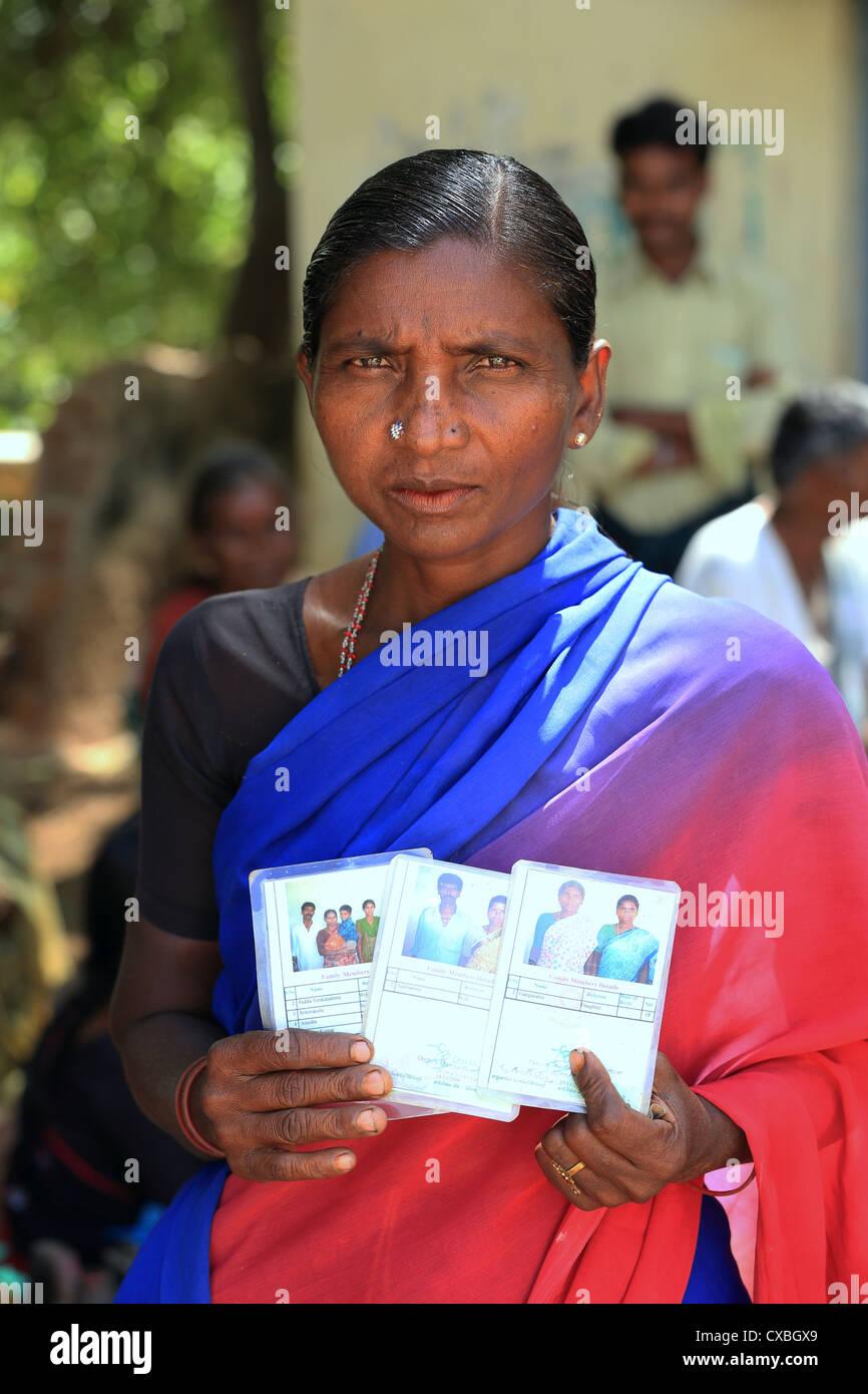 Rural woman with discounted kerosene card Andhra Pradesh South India - Stock Image