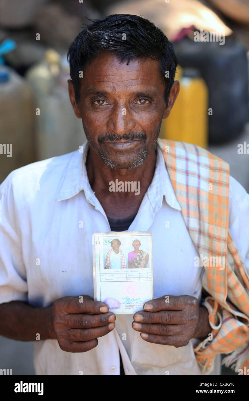 Rural man with discounted kerosene card Andhra Pradesh South India - Stock Image