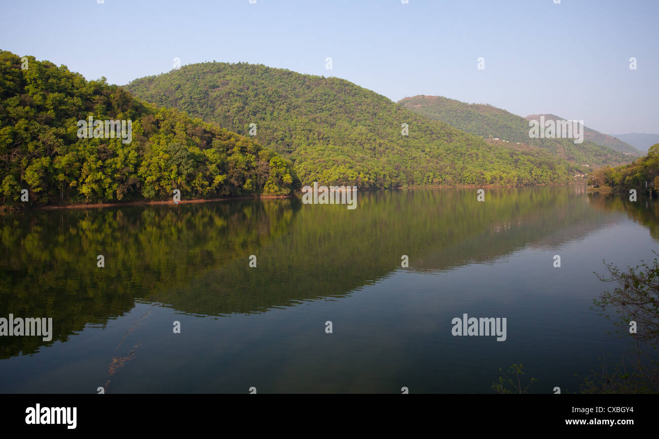 Phewa Tal, a fresh water lake in Pokhara surrounded by green hills, Nepal - Stock Image