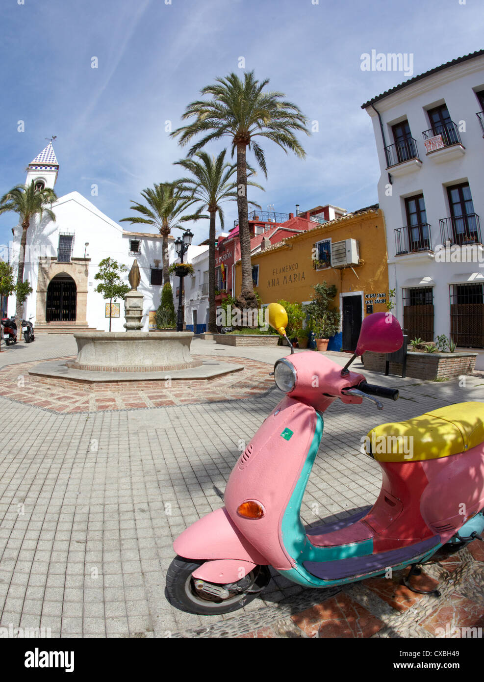 Traditional Church Square And Vespa Scooter In Marbella Old Town Spain - Stock Image