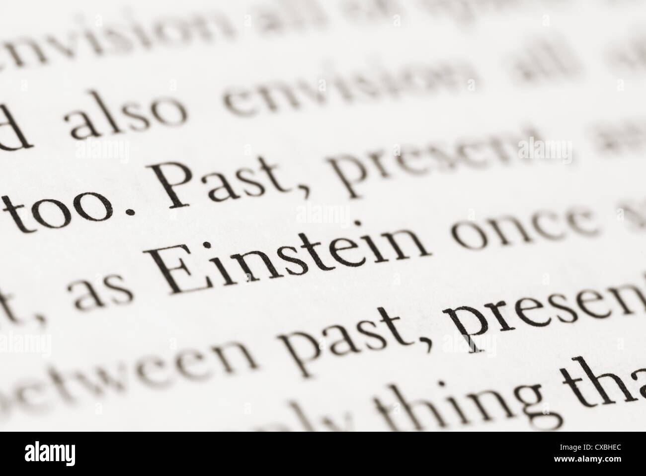 This is an image of text from a particle physics book, highlighting the word Einstein - Stock Image