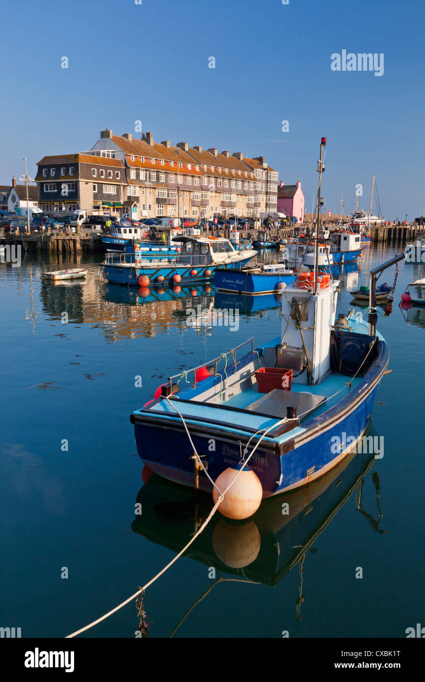 West Bay harbour with yachts and fishing boats, Bridport, gateway town for the Jurassic Coast, Dorset - Stock Image