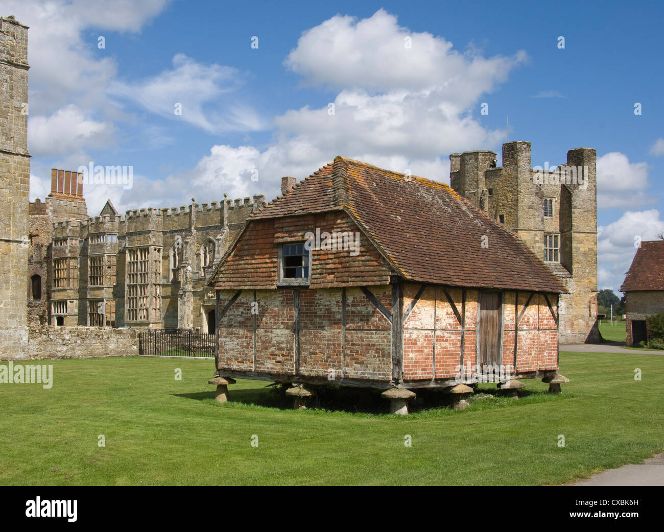 A Medieval granary, set on toadstools to prevent access by rats, Cowdray Castle, Midhurst, West Sussex - Stock Image